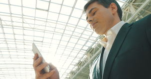 Businessman with Smartphone in Modern Building stock footage