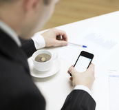 Businessman with smartphone reading news Stock Image