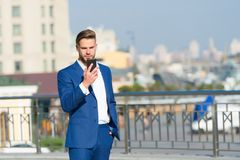 Businessman with smartphone on sunny terrace. Man in business suit with mobile phone outdoor. Business communication, new technolo. Gy and sms. Modern life and royalty free stock photography