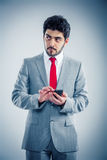 Businessman with smartphone Stock Photography