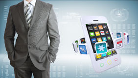 Businessman with smartphones and colorful apps Stock Images