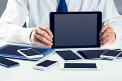 Businessman with smartphones and tablet Stock Photo