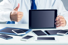 Businessman with smartphones and tablet Stock Images