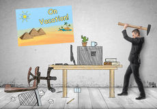 Businessman smashing his workplace with hammer Royalty Free Stock Images