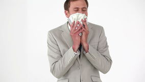 Businessman smelling bank notes Royalty Free Stock Image
