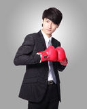 Businessman smile with boxing gloves Royalty Free Stock Images