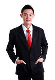 Businessman smile wearing an red tie and black suit on white bac Stock Photos