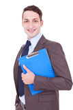 Businessman smiles with clipboard in his hand Royalty Free Stock Photos