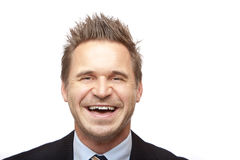 Businessman smiles happy into camera Stock Photos