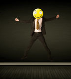 Businessman with smiley face Stock Photography