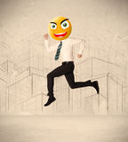 Businessman with smiley face. Funny businessman with yellow smiley face stock images