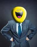 Businessman with smiley face instead of head Stock Images
