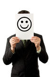 Businessman with smilie. Businesman is holding a smilie royalty free stock photography