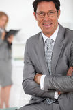 Businessman smiling Stock Photos