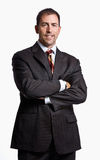 Businessman smiling with arms crossed Royalty Free Stock Photography