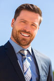 Businessman smiling. Businessman with beard and blue eyes wearing a blue suit and smiling at the camera Stock Images