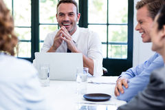 Businessman smiling in a business meeting Royalty Free Stock Images