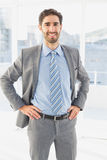 Businessman smiling at the camera Royalty Free Stock Images