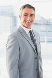 Businessman smiling at the camera Stock Image
