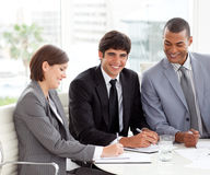 Businessman smiling at the camera in a meeting Stock Photo