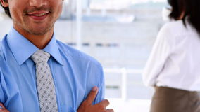 Businessman smiling at camera wearing a smart watch stock video
