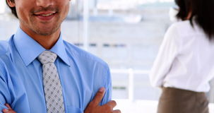 Businessman smiling at camera wearing a smart watch stock footage