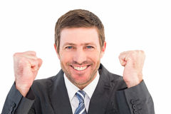 Businessman smiling and cheering Royalty Free Stock Photos