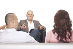Businessman Smiling In Front Of Two Colleague stock photography