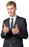 Businessman smiling and giving ok Stock Photography