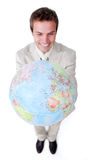 Businessman smiling at global business expansion. Visionary Businessman smiling at global business expansion against a white background stock photo