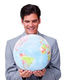 Businessman smiling at global business expansion Stock Photography