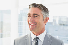 Businessman smiling at his office Stock Images