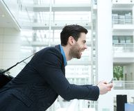 Businessman smiling and holding cellphone Stock Photos