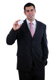 Businessman smiling holding a white business card Stock Photo