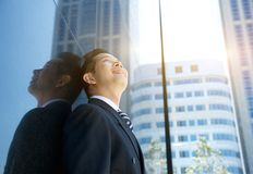 Businessman smiling and looking up Royalty Free Stock Images