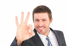 Businessman smiling and making ok sign Royalty Free Stock Photography