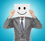 Businessman with smiling mask Stock Photography