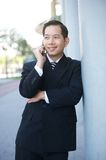 Businessman smiling with mobile phone Stock Photography