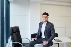 Businessman smiling at the modern office . Business portrait Stock Photos