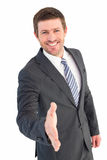 Businessman smiling and offering his hand Stock Images