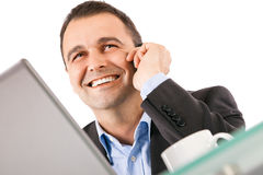 Businessman smiling phone Royalty Free Stock Photos
