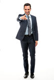 Businessman smiling and pointing finger Stock Images