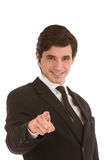 Businessman smiling and pointing forwards Royalty Free Stock Image