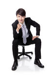 Businessman smiling and pointing to you Royalty Free Stock Photos