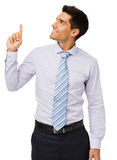 Businessman Smiling While Pointing Upwards Royalty Free Stock Photos