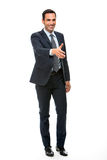 Businessman smiling raising his arm for shaking hands Stock Photography