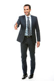 Businessman smiling raising his arm for shaking hands Royalty Free Stock Image