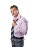 Businessman. Smiling man wearing tie on white background royalty free stock photography