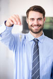 Businessman smiling while showing house keys Royalty Free Stock Photo