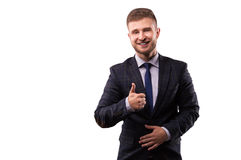 Businessman smiling and shows thumb up stock photography